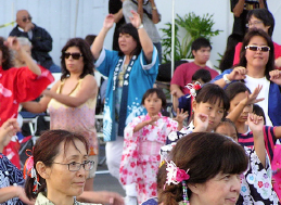 Women wearing yukata dance at the SEJSCC Cultural Festival