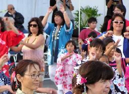 Women wearing yukata dance at the SEJSCC Cultural Festival