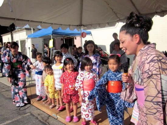 Marisa Kosugi of Matsutoyo-Kai and Minyo Station interviewing children before last year's Bon Dance.