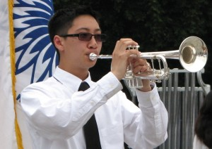 "Timothy Moy, grandson of an MIS veteran, played ""Taps."""
