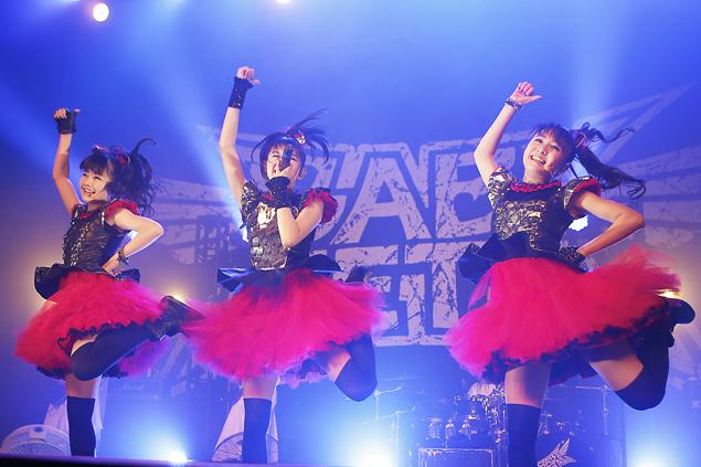 Babymetal members Yuimetal, left, Su-metal and Moametal perform July 27 at the Fonda Theatre. (Darren Yamashita)