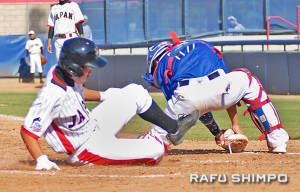 Daiki Arimoto slides safely into home past UYA catcher Brendon Casillas, in Japan's 7-1 victory on Sunday. (MIKEY HIRANO CULROSS/Rafu Shimpo)