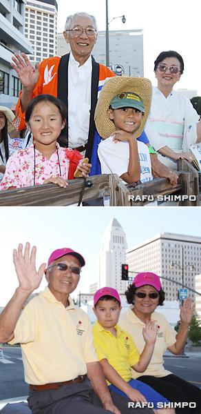トラクターの荷台に乗るカワセさん夫妻と孫たち(写真上)グランドパレードに参加した米澤義人、純子さん夫妻。中央は、孫のフェイランくん(同下)