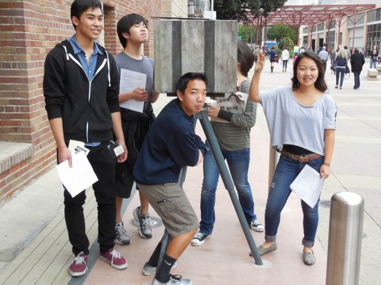 During a scavenger hunt, Nick Yamamoto clutches the Toyo Miyatake replica camera as Ryuta Shimoida, Sam Abe and Kara Tanaka pose. (Photo by Cyril Nishimoto)