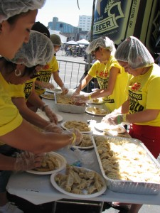 Volunteers prepare plate after plate of gyoza.