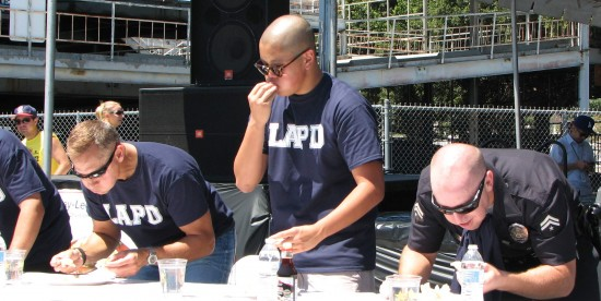 In the contest prior to the main event, LAPD officers (above) could not keep up with the L.A. Fire Department (below). The score was
