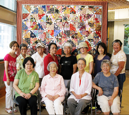 "Little Tokyo Library Quilters with this year's raffle quilt, ""Pinwheels."" (Photo by Pedro Trujillo)"