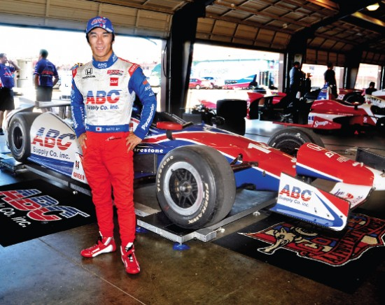 Takuma Sato poses with his car at Auto Club Speedway last September. (Photo by Tim Yuji Yamamoto)