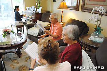 Residents at JP Senior Homes enjoy singing in their shared living room.