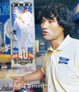 Park discusses his career in front of a large banner of himself featured in the JANM exhibit.