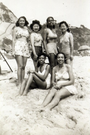 "Among the Nisei discussed in ""City Girls"" are Hisaye Yamamoto DeSoto (standing, right) and Mary Kitano (standing, second from left). They worked at The Los Angeles Tribune, an African American newspaper, in the late 1940s and are pictured at the beach with some of their co-workers in this undated photo.  (Courtesy J.K. Yamamoto)"