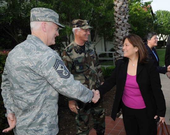 Chief Master Sgt. Andy Kaiser, Air Force Personnel Center command chief, greets Debra Wada, staff member of the House Armed Services Committee's Subcommittee on Military Personnel, outside AFPC at Joint Base San Antonio in Randolph, Texas, in April 2009. (U.S. Air Force Photo)