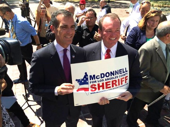 Mayor Eric Garcetti (left) and L.A. County sheriff candidate Jim McDonnell pose outside City Hall.