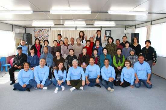 During its goodwill tour to Japan, members of the Grateful Crane Ensemble performed for this group of tsunami survivors at a temporary housing facility in Ishinomaki, Miyagi Prefecture. Grateful Crane members included (front row, from left) Haruye Ioka, Soji Kashiwagi, Keiko Kawashima, Darrell Kunitomi, Jason Fong, Kurt Kuniyoshi, Mary Kageyama Nomura and Scott Nagatani.  (Photo by Darrell Miho)