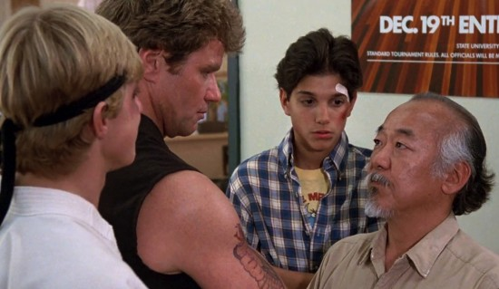 Miyagi and Daniel visit the Cobra Kai dojo and meet with Johnny (Billy Zabka) and his sense, Creese (Martin Kove).