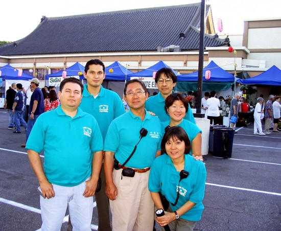 Nancy Kikuchi (standing at right) and members of the Little Tokyo Public Safety Association conduct patrols at the Nishi Obon.
