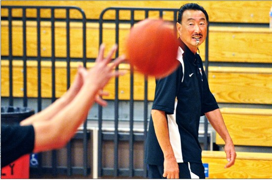 Steve Yano makes the rounds during a girls' basketball team practice at Troy High School in Fullerton. Yano, who died in a tragic accident last week, will be remembered in services on Saturday. (Photo courtesy Susan Yano)
