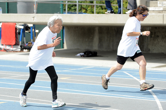 Octogenarian Sumi Onodera-Leonard, left, and Sandra Nitta compete in the women's 100-meter dash.