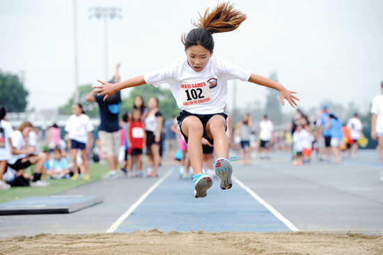 In the girls' long jump, Kendall Oda takes flight on her way to a gold medal.