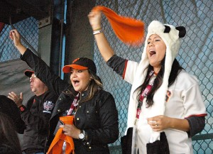 "Clad in her furry panda cap and cheering on every pitch, San Francisco resident Hiroko Shirakata, right, and friend Andrea Valencia scored a pair a World Series tickets just prior to game time. With the Giants trailing late in Friday's game, Shirakata hadn't lost hope. ""No worries, we'll win,"" she insisted."