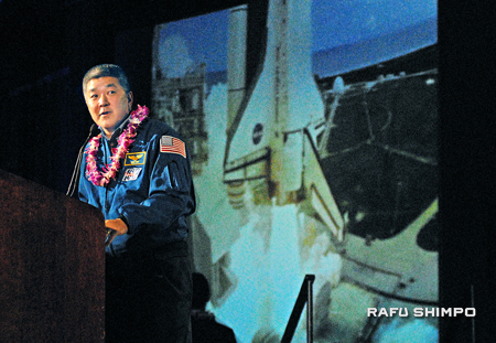 Former astronaut Daniel Tani's presentation included footage of the space shuttle taking off and views of the Earth from space.