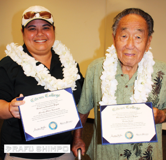 Kayle Matsushima, representing Masako Mukai Kusumoto, and Toshio Asano display honorary associate of arts degrees they received at Citrus College on Oct. 21. (GWEN MURANAKA/Rafu Shimpo)