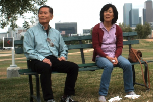 "George Takei and Sharon Omi in a scene from ""Eat with Me."""