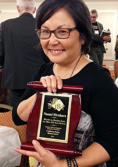 Naomi Hirahara was presented with the awrd
