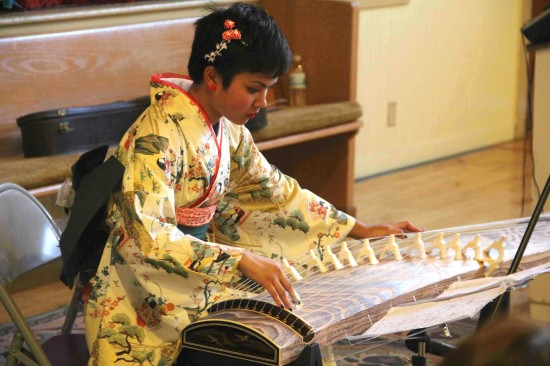 Isabella Lew plays the koto.
