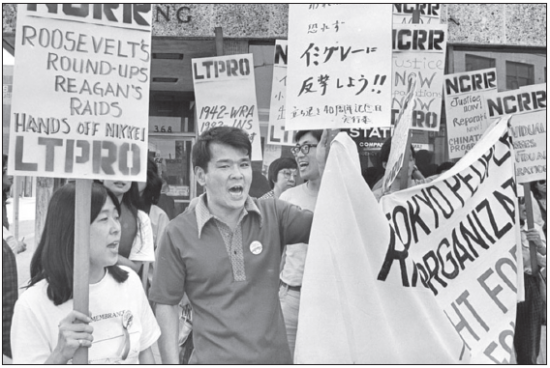 Members of LTPRO (Little Tokyo People's Rights Organization) protest.