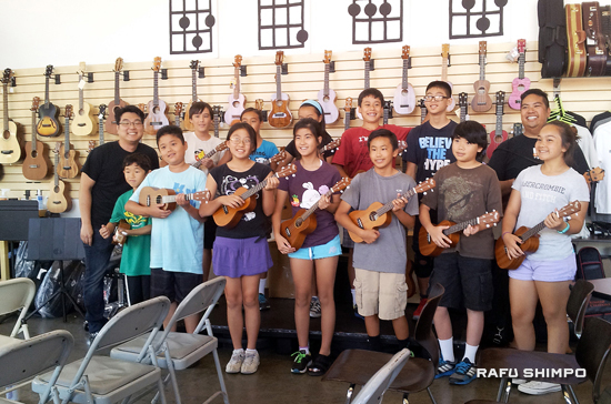 Campers take a ukulele lesson at the JACCC's U-Space with Jason Arimoto and Brad Ranola.