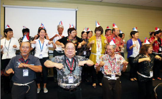 Front row, from left: Edward Sakoda, Steve Sato and David Watanabe lead friends and family in the chicken dance.