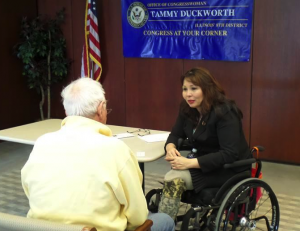 "Rep. Tammy Duckworth talks to a constituent at a recent ""Congress at Your Corner"" event."