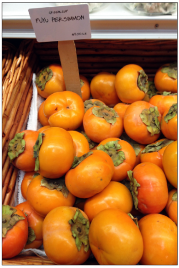 Fuyu persimmons on sale for $3 a pound at Dean and DeLuca in Napa. (GWEN MURANAKA/Rafu Shimpo)