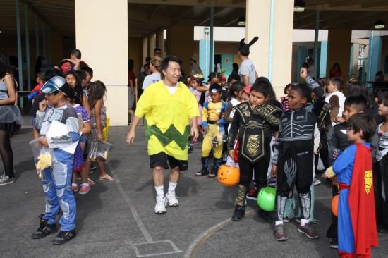 JAO member Billy Wing as Charlie Brown and elementary kids in a costume contest walk.