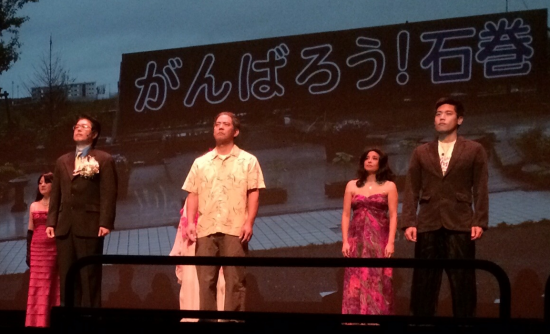 "The ensemble sang ""Hana wa Saku"" in tribute to the survivors of the 2011 Tohoku earthquake and tsunami."