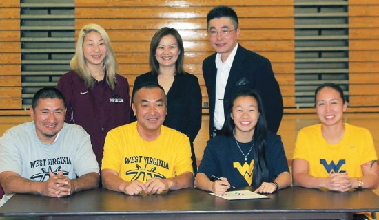 At Wednesday's Letter of Intent signing at Mark Keppel High School: Front from left — Coach Gino Torres, Varsity head coach Joe Kikuchi, Lauren Saiki, assistant coach Krista Arase. Back — Frosh/soph coach Kylie Yoshimura, and Saiki's parents, Lora M. Soo Hoo Saiki and Robert T. Saiki.