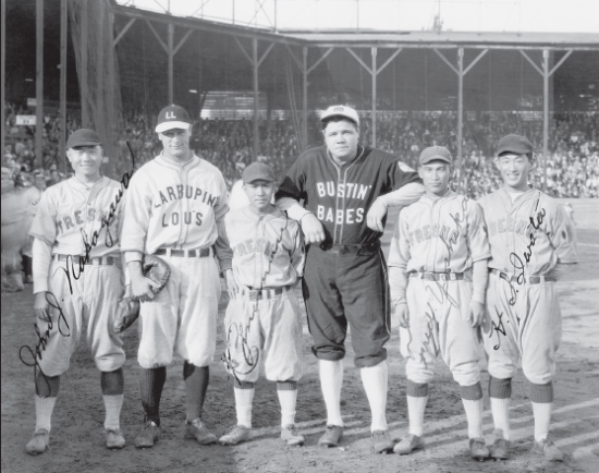Babe Ruth and Lou Gehrig barnstormed the West Coast after the 1927 World Series. Their stops included Fresno, where they took part in an exhibition game with Kenichi Zenimura (to Ruth's right) and Nisei baseball teams. (Nisei Baseball Research Project)