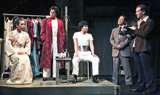 """Tensions are revealed by Nigel's (Joseph Lim Kim) questions during an interview with the Takarazuka """"top stars"""" (Grace Yoo, Fiona Cheung, Klarissa Mesee) as theater headmaster Ariyoshi (Michael Hagiwara) observes in East West Players' production of """"Takarazuka!!!"""" (Photo by Michael Lamont/EWP)"""