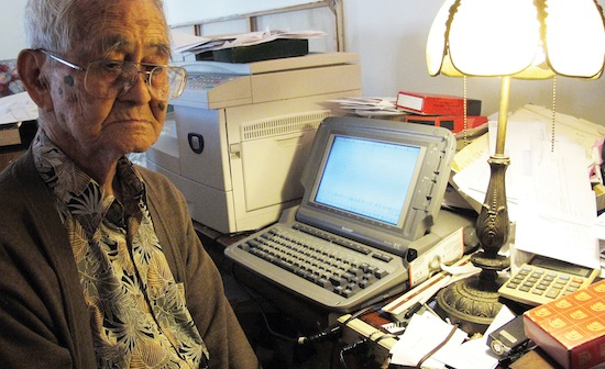 Yamashiro sits at his word processor at his home in West Los Angeles.