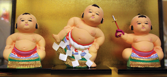 A trio of sumo wrestlers that are among the Japanese ceramics sold at Bunkado.