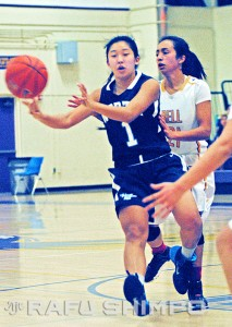 North High's Ryley Kamiya gets off a pass while guarded by Teresa Robolledo, during the game at Bell High.