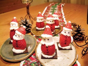 Strawberries are cut, and whipped cream is put between the pieces to make a strawberry Santa Claus. (Courtesy of Kanako Tanaka)