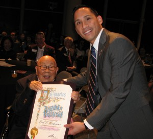 Fred Hoshiyama receives a proclamation from Los Angeles City Councilmember Mike Bonin, presented by field deputy Nguyen.