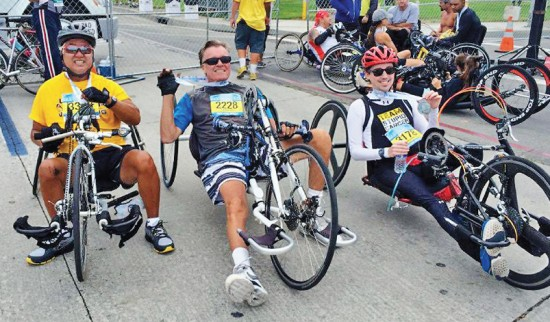 In this photo on his Facebook page, David Ogata of Garden Grove (left) poses with fellow handcyclists after completing the 2014 Long Beach Marathon on Oct. 12. Partially paralyzed and able to hand-crank with only his left arm, Ogata completed the 26.3-mile course in just under 2 hours and 25 minutes. With Ogata is Charles Cook of Huntington Beach (center) and Jason Mlot of Redlands.