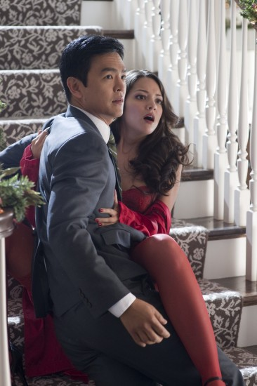 "John Cho as Harold and Paula Garcés as Maria in ""A Very Harold and Kumar 3D Christmas."""
