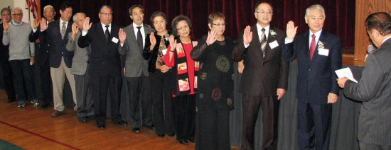 Former Assemblymember George Nakano (right) installed the VJCC officers and board.