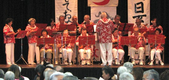Ukulele performance by Venice Hui Akane, led by Bob Matsunaga.