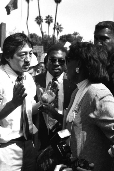 Mike Murase at a rally against police brutality in 1991.