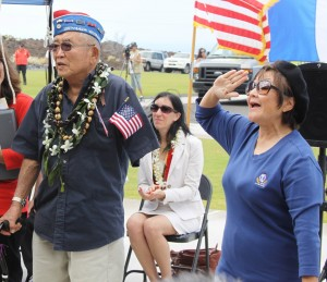 "Don Seki, a past Legion of Honor recipient, sings the ""442 Fight Song"" with hula accompaniment by Lynette Seki Takahashi."